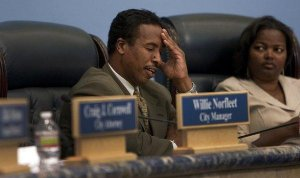 Compton Mayor Eric Perrodin tries to keep his composure at a 2011 City Council meeting. His seat and two council seats are up for grabs in the city's upcoming municipal election.