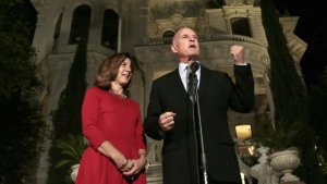Gov. Jerry Brown delivers his victory speech with wife Anne Gust Brown at his side in front of the governor's mansion in Sacramento. (Credit: Los Angeles Times)