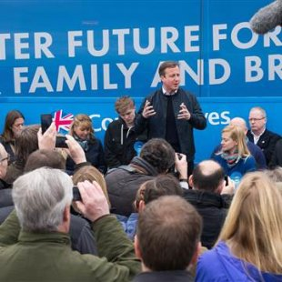 Image: Prime Minister David Cameron talks to supporters on April 4