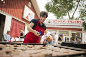 Joni Ernst, Iowa Republican Senate candidate, helps out on the grill in the Pork Tent at the 2014 Iowa State Fair.