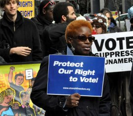 Occupy Wall Street joined the NAACP as thousands marched in midtown Manhattan on December 10, 2011 to defend voting rights.